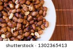 roasted peanuts snack in white... | Shutterstock . vector #1302365413