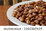 roasted peanuts snack in white... | Shutterstock . vector #1302365419