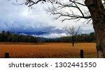 dramatic late autumn cloudscape | Shutterstock . vector #1302441550