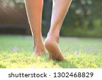leg of woman is on walk down... | Shutterstock . vector #1302468829