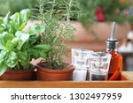 fresh mint and rosemary in pots ... | Shutterstock . vector #1302497959