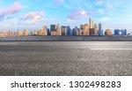 empty asphalt road and modern...   Shutterstock . vector #1302498283