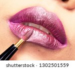close up of painting purple... | Shutterstock . vector #1302501559