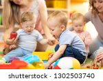 babies with moms playing in day ... | Shutterstock . vector #1302503740