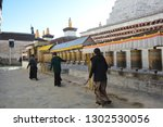 tibetan women rolling prayer... | Shutterstock . vector #1302530056