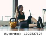 woman exercise at gym fitness... | Shutterstock . vector #1302537829