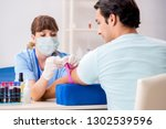 young patient during blood test ... | Shutterstock . vector #1302539596