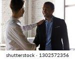 millennial caucasian boss... | Shutterstock . vector #1302572356