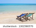 couple loungers on a tropical... | Shutterstock . vector #1302580570