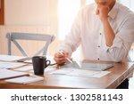 businessman sitting in a... | Shutterstock . vector #1302581143