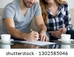 close up view of couple signing ... | Shutterstock . vector #1302585046