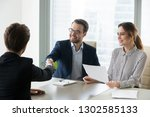 happy satisfied hr manager... | Shutterstock . vector #1302585133