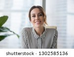 smiling businesswoman looking... | Shutterstock . vector #1302585136