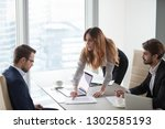 Stock photo angry female client customer worker pointing at mistake in business document having complaint 1302585193