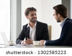 happy businessmen partners... | Shutterstock . vector #1302585223