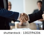 close up of two executive... | Shutterstock . vector #1302596206