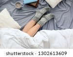 young woman lying on bed ... | Shutterstock . vector #1302613609