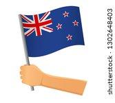 new zealand flag in hand.... | Shutterstock .eps vector #1302648403