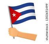 cuba flag in hand. patriotic... | Shutterstock .eps vector #1302651499