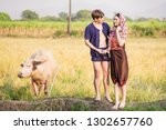 farmers couples are loving each ... | Shutterstock . vector #1302657760