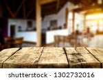 desk of free space and blurrred ... | Shutterstock . vector #1302732016
