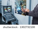 man hand holding tablet or cell ... | Shutterstock . vector #1302732100