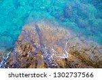 beach stone summer blue sea...   Shutterstock . vector #1302737566