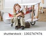 little boy imagines himself as... | Shutterstock . vector #1302767476