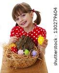 happy little girl with easter... | Shutterstock . vector #130279604