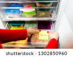 woman placing container with... | Shutterstock . vector #1302850960