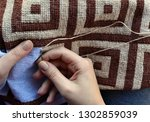 woman embroidering traditional... | Shutterstock . vector #1302859039