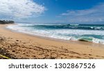 waves crashing on the shore of...   Shutterstock . vector #1302867526
