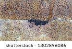 rusty metal plates joint... | Shutterstock . vector #1302896086