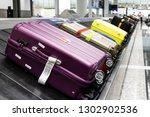 baggage luggage on conveyor... | Shutterstock . vector #1302902536