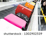 baggage luggage on conveyor... | Shutterstock . vector #1302902539