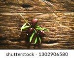 olives on olive branch. wooden... | Shutterstock . vector #1302906580