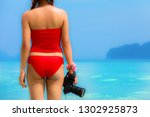 woman in red swimming suite... | Shutterstock . vector #1302925873