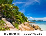 amazing beach with palm trees... | Shutterstock . vector #1302941263