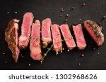 grilled meat recipe. rare steak ...   Shutterstock . vector #1302968626