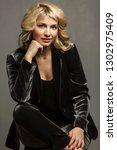 beautiful business woman in a... | Shutterstock . vector #1302975409