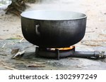 giant pot used for cooking... | Shutterstock . vector #1302997249