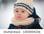 baby playing with teddy in the... | Shutterstock . vector #1303004236