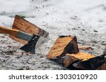 sharp axe cuts wood logs | Shutterstock . vector #1303010920
