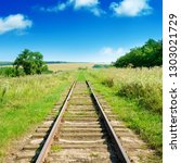 old railway track among summer... | Shutterstock . vector #1303021729