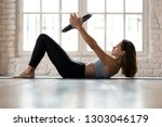 young sporty attractive woman... | Shutterstock . vector #1303046179