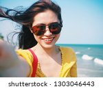 happy young asian woman selfie... | Shutterstock . vector #1303046443