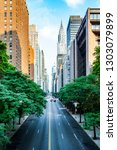 Small photo of 42nd street, Manhattan viewed from Tudor City Overpass New York City during sunny summer daytime at sunset