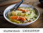 tasty home broth with... | Shutterstock . vector #1303105939