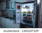 an open refrigerator full of... | Shutterstock . vector #1303107109