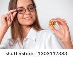 mature woman wearing eyeglasses ... | Shutterstock . vector #1303112383